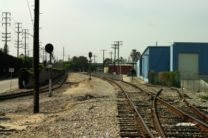 Yard entrance track on the left and branch line on the right.